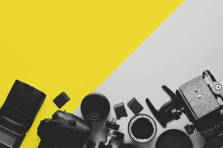 Digital camera, lenses and equipment of the photographer on a grey background Imagens
