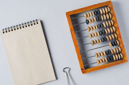 Old wooden abacus on grey background. The concept of bookkeeping, business or saving money 版權商用圖片