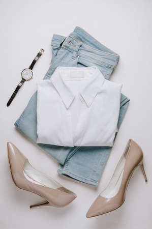 Women's clothing on a pale background. Flat lay and top view