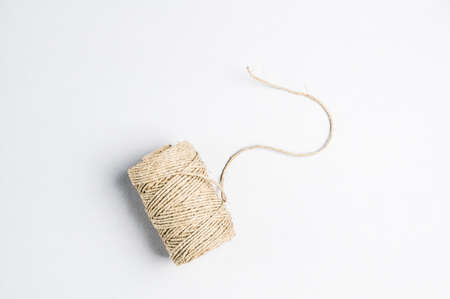 Clew of rope on a light background. Place for text