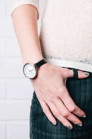 Wristwatches on womens hand