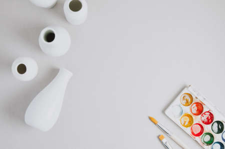 White utensils for creativity and paint on a light background