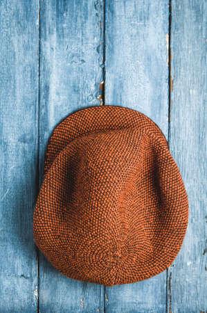 Womens vintage hat on blue background