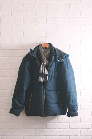 Blue men's jacket on white brick wall Stock Photo - 121678200