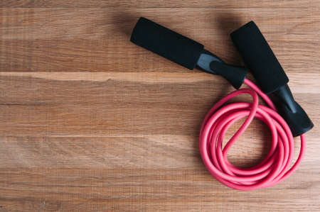 Skipping rope on wooden background