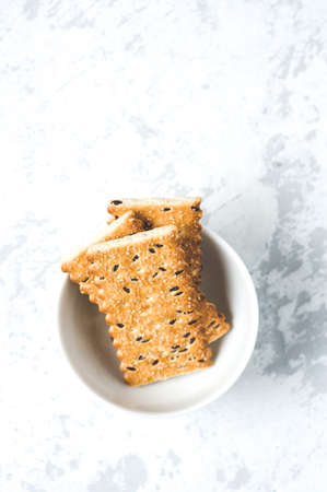 Cookies in a white Cup on a white background Stockfoto