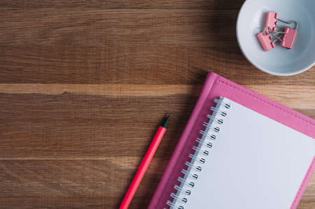 Pink notebooks and stationery on the table