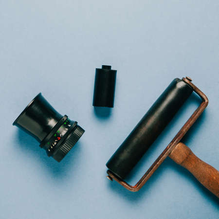 Old lens and development tools on blue background