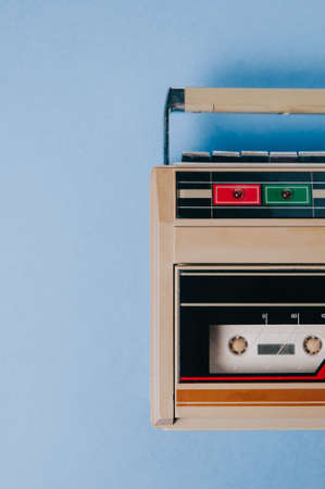 Old cassette tape recorder on a blue background