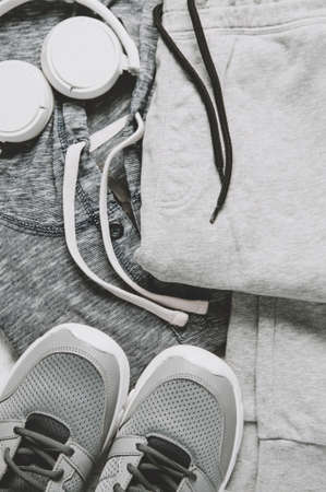 Sportswear and sneakers on the grey background. The concept of sport or exercise