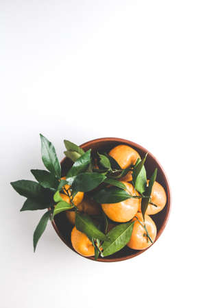 Tangerines in a plate on a light background