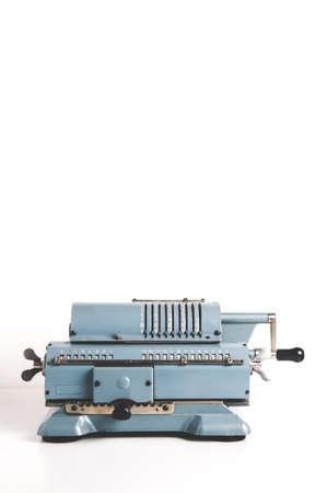 Old counting machine on white background Standard-Bild - 121679248