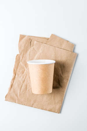 Paper cups for coffee on a light background. Template for text or design Stock Photo