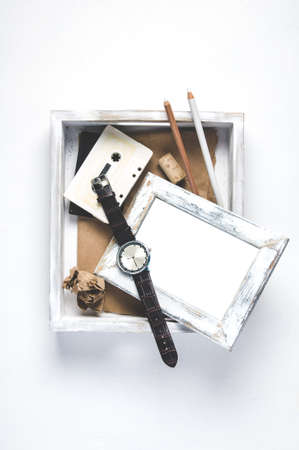 Unnecessary things in a white wooden box
