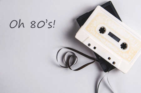 White and black audio cassettes on a light background. Place for text Stok Fotoğraf