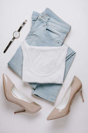 Womens clothing on a pale background. Flat lay and top view