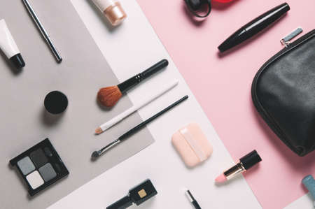 Womens cosmetics on pale background