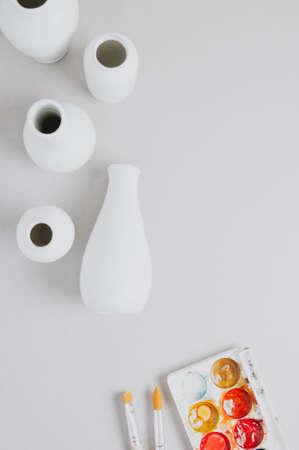 White utensils for creativity and paint on a light background Standard-Bild - 121679763
