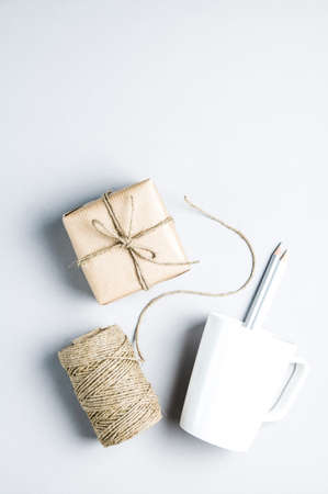 Clew of rope and gift on a light background. Place for text