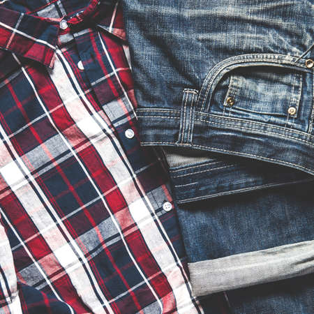 Men's clothing - jeans and t-shirt. Flat lay and top view