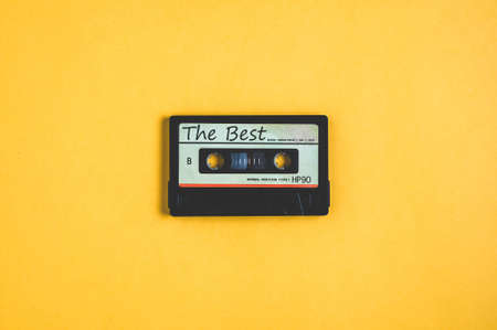 Old audio cassette tape on a yellow background Stok Fotoğraf
