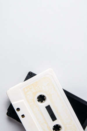 White and black audio cassettes on a light background. Place for text Stock Photo
