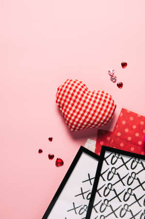 Valentines day concept. Heart and frame and on pink background