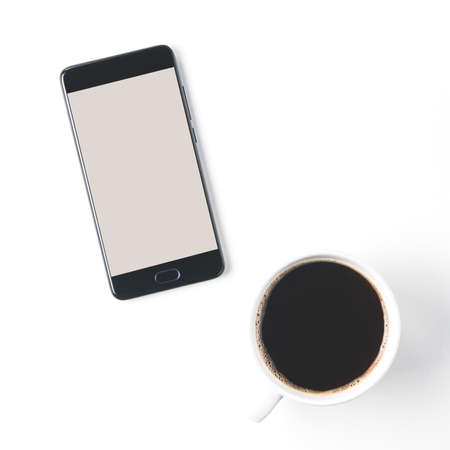A Cup of coffee and a smartphone on a light background. Template for design or application Stok Fotoğraf