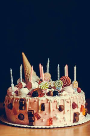 Homemade cake on a dark background, concept of holiday or birthday