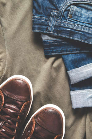 Mens clothing - jeans, sneakers and t-shirt. Flat lay and top view