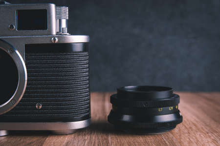 Old camera and lens on dark background