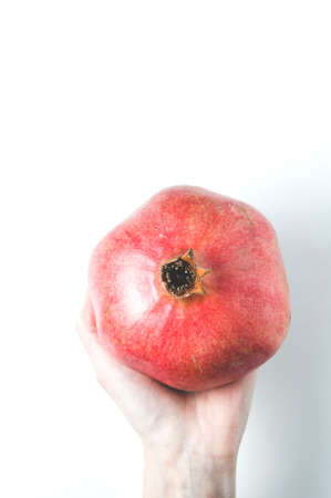 Red pomegranate in a woman hands Stok Fotoğraf