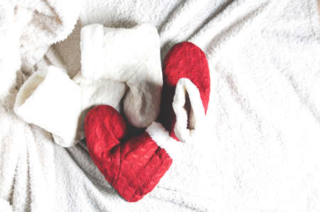 Red and white Slippers on a light background