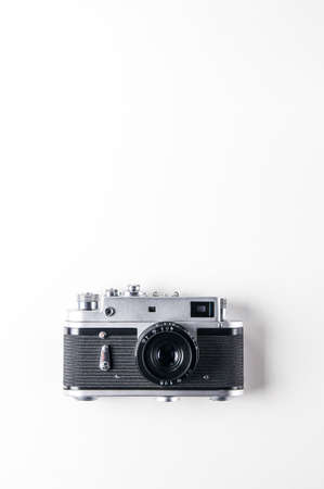 Old camera on a light background. Place for text 版權商用圖片 - 121679937