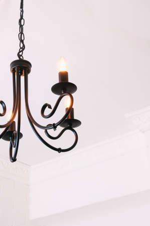 Black chandelier in white interior Stock Photo