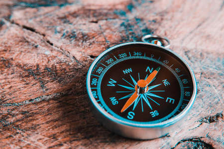 Old compass on a dark wooden background. Copy space for text or design 스톡 콘텐츠