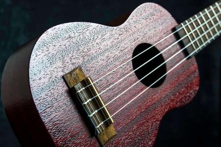 Mahogany ukulele close-up on dark background