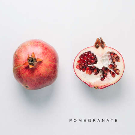 Red pomegranate isolated on white background. Flat lay and top view