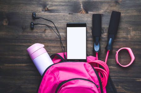 Pink backpack with sportswear and a jump rope. The concept of fitness or running Reklamní fotografie