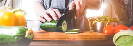 Cook cutting raw vegetables on a cutting Board 写真素材