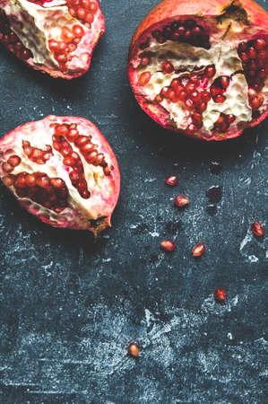 Ripe pomegranates on a dark background