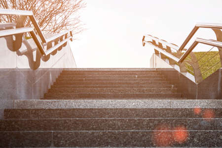 Stairway with metallic banister. The concept of success or climbing