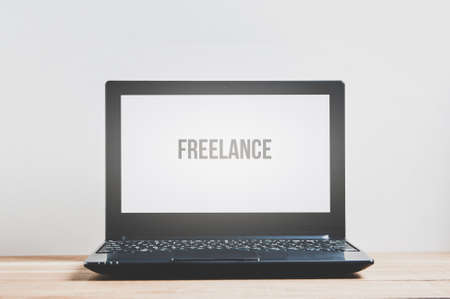 Laptop on a pale background. Template for text or design