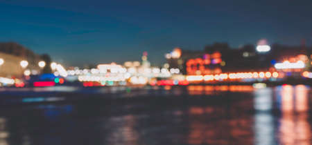 City embankment in the evening. Blurred and defocused