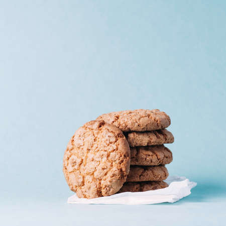 Homemade cookies isolated on turquoise background Фото со стока