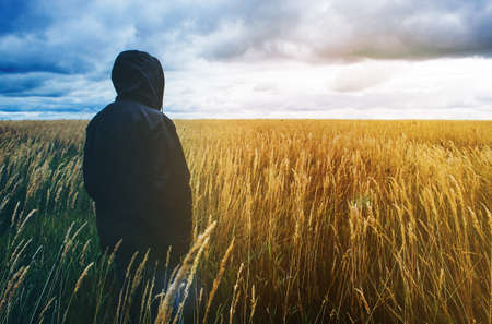 Man in a field before the storm