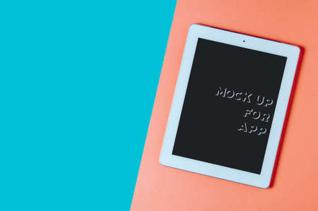 White tablet computer on pink background. Template for app or web site Фото со стока