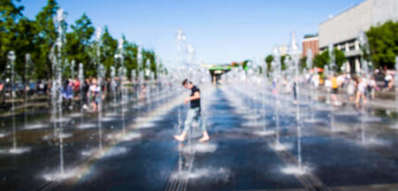 Blur and defocus. People walk in the Park. The concept of the urban landscape Фото со стока