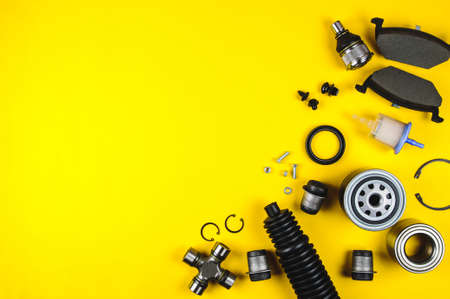 Set of car parts for maintenance on yellow background Stockfoto