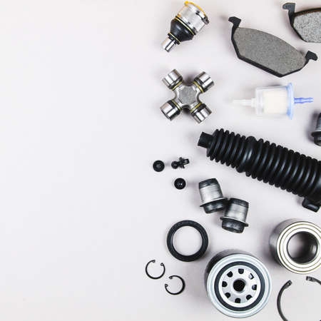 Set of car parts for maintenance on grey background Stockfoto